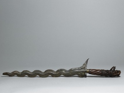 Ceremonial dagger or keris, with metal blade and wooden handle with carved decoration