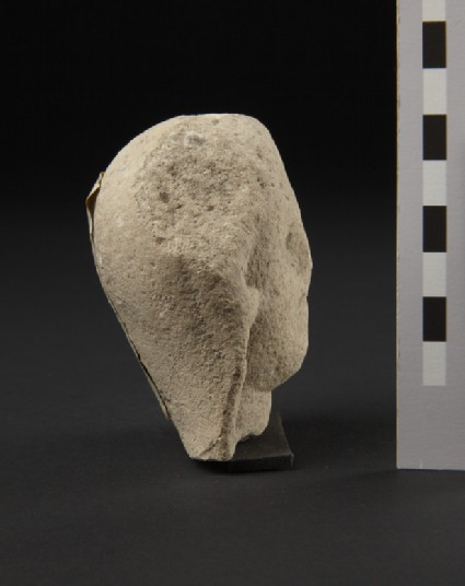 Limestone head of female votary, veiled, fragment of votive-statuette