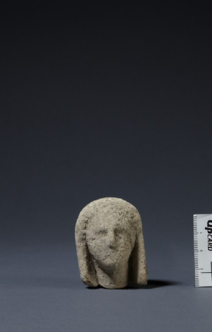 Limestone head of female votary, veiled, fragment of votive-statuette votive statuette
