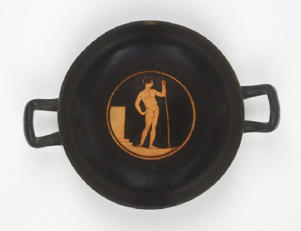 Attic red-figure pottery stemless cup depicting an athletics scene