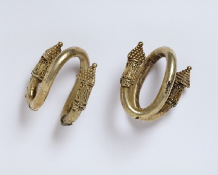 Pair of electrum and bronze ear-rings with granulated decoration