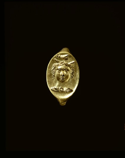 Ring with intaglio depicting a youth with wings or horns on his head and cicada above