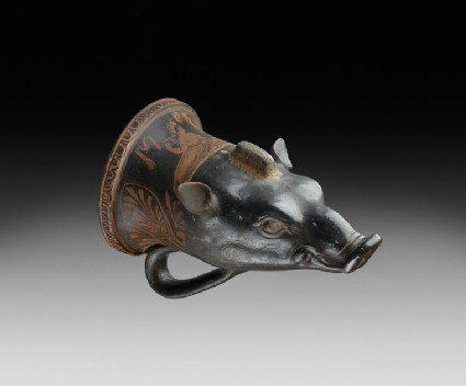 Apulian red-figure pottery rhyton shaped like a boar's head depicting a symposiastic scene