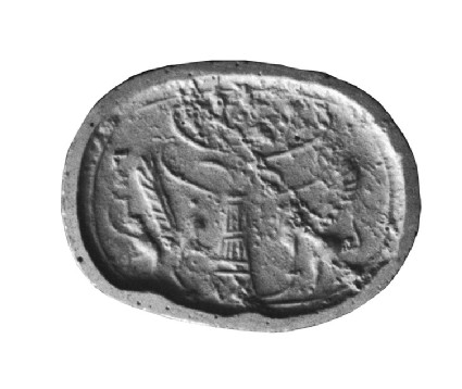 Scaraboid stamp seal, a griffin, disk on head, on either side of a stylized tree