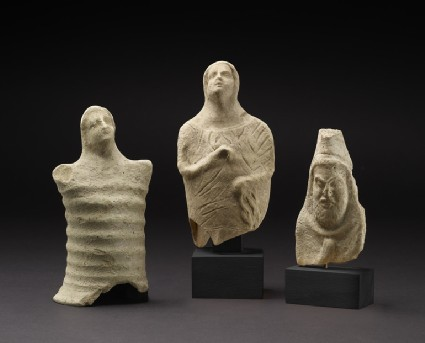 Female votary figure, crude cylindrical ridge body and arm-stumps