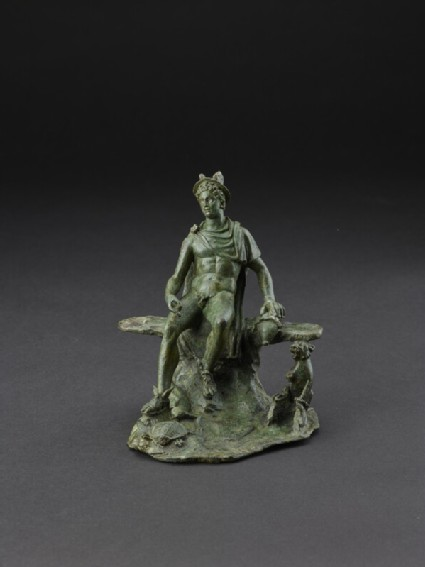 Bronze statuette of Mercury seated on a rocky bench