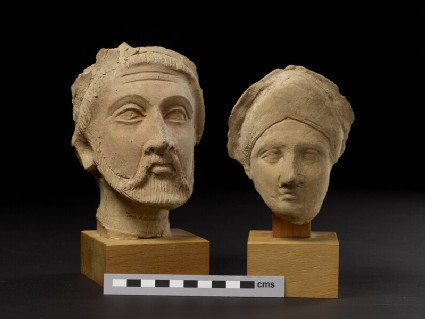 Head of bearded male, fragment of funerary figure