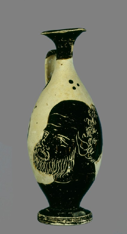 Black-figure pottery lekythos (oil-jar) with the head of Silenus