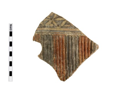 Fragment of large male votive figure, cuirass with tassel fringe around waist and star-pattern