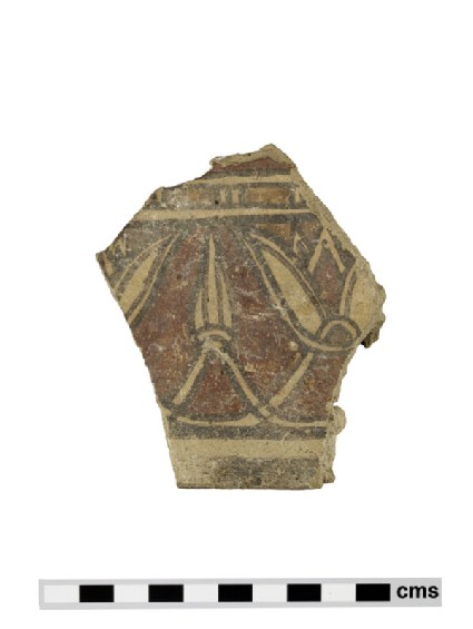 Fragment of large votive figure, cuirass with frieze of alternating lotus flowers and lotus buds