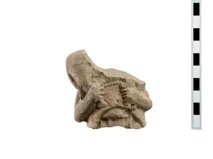 Limestone statuette torso fragment of a man carrying a sheep or lamb on his shoulder, head an lower body missing