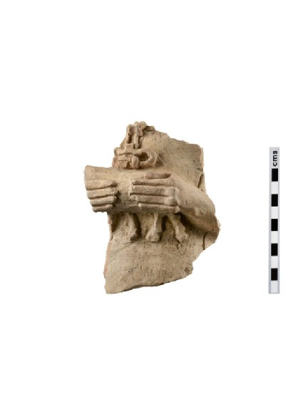 Fragment of a terracotta figurine of a female votary holding miniature calf