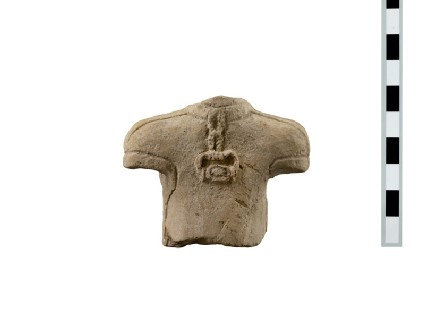 Torso of a fragmentary terracotta votary figure wearing a pendant (seal in claw setting)