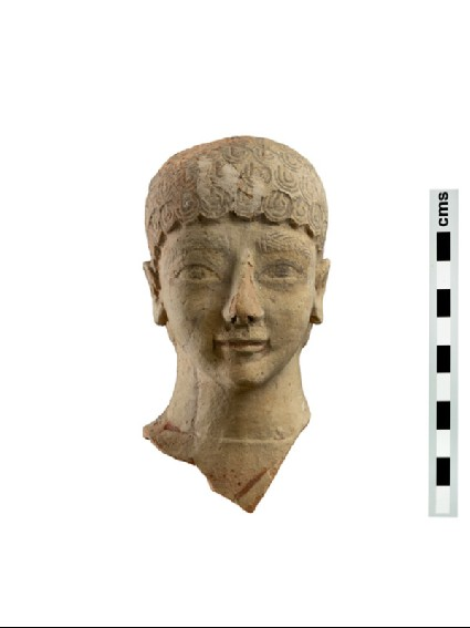Head of terracotta votive figure of male youth with short curly hair
