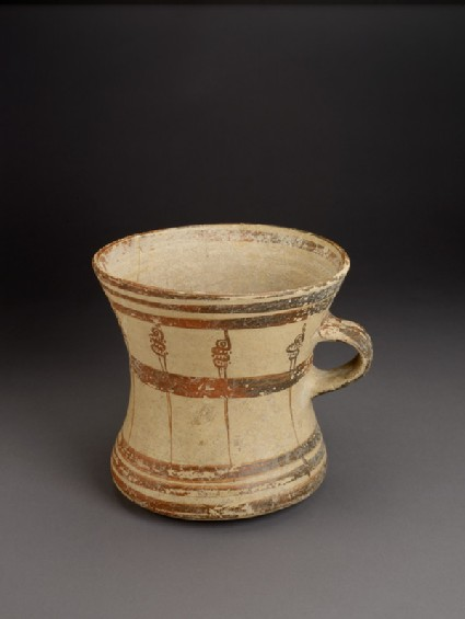 Mycenaean tankard decorated with painted murex shells and bands