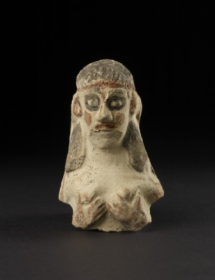 Naked female figurine clutching her breast, upper torso, so-called Astarte-figurine