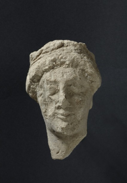 Limestone head of female votary with fillet, votive-statuette