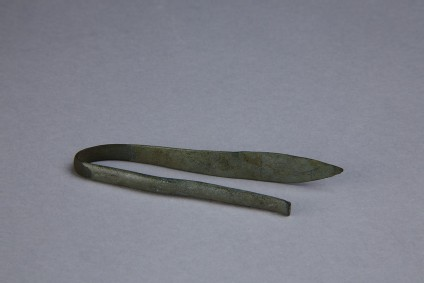 Miniature bronze spear with shaft bent