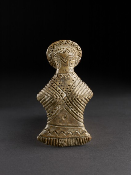 Female figurine with white-filled incised decoration