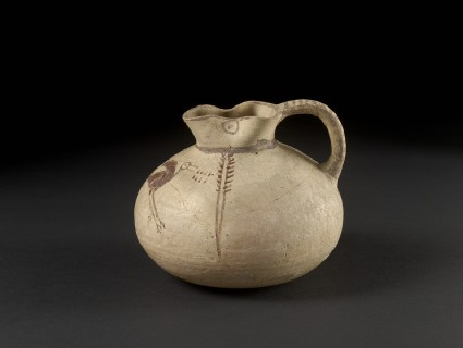 Bichrome sack-shaped juglet decorated in free-field style with a water bird (ibis) and reeds