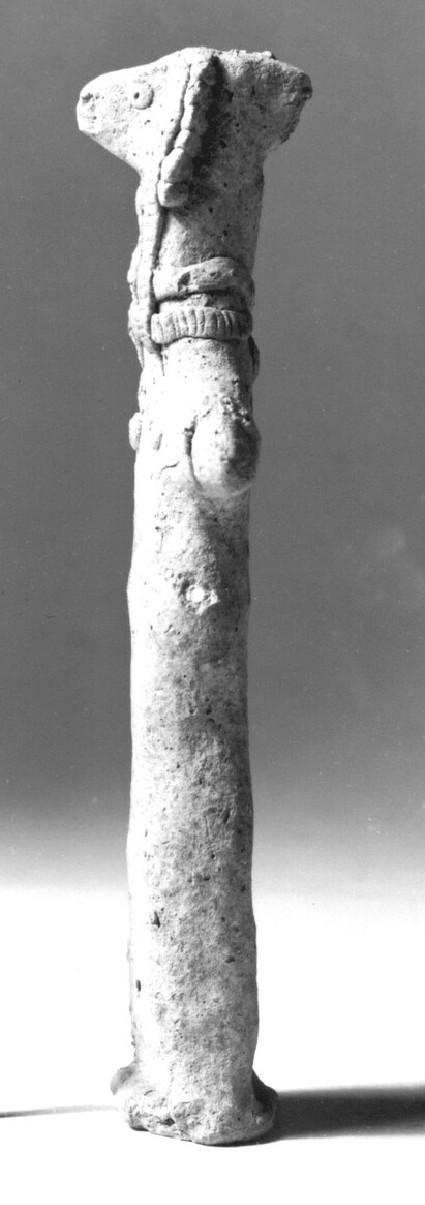 Female figurine, goddess wearing fringed hood, two long locks falling in front