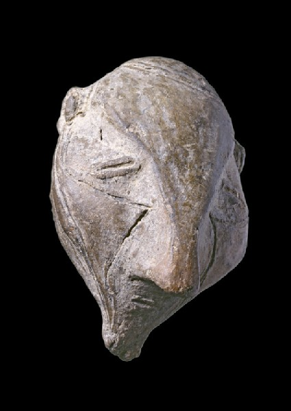 Head of a figurine representing either a man or a god