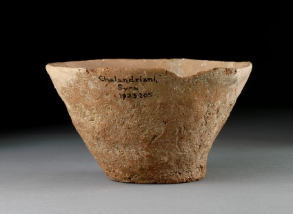 Pottery cup with vine leaf impression on base