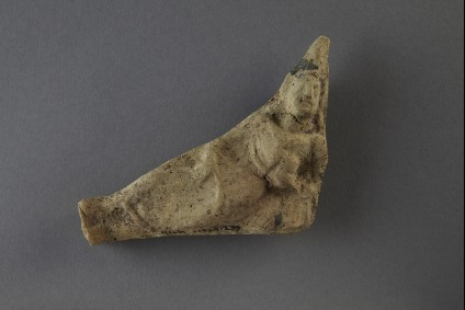 Reclining female figurine