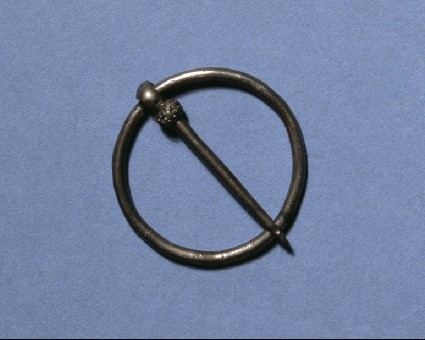 Annular brooch with highly ornamented boss