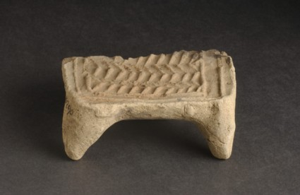 Fragment from a model of a bed