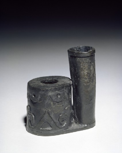 Lead inkpot with decorated pen stand