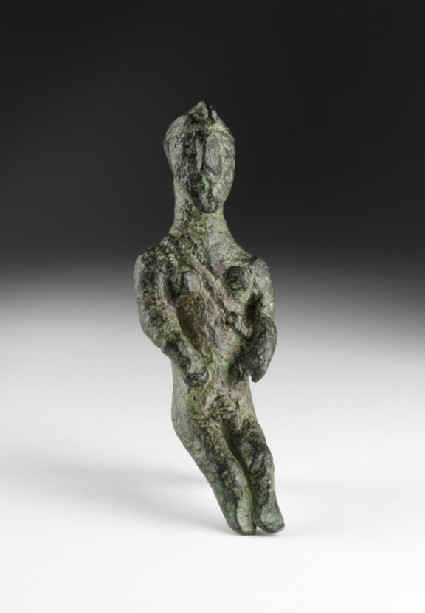 Male figurine, seated warrior wearing cap