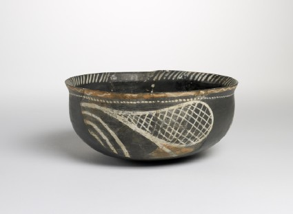 Polychrome bowl with red and white 'racquet' pattern