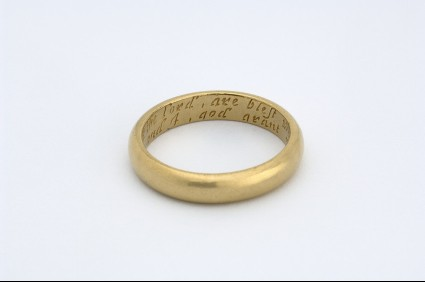 Gold posy ring with engraved circular hoop