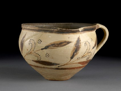 One-handled cup decorated with floral designs