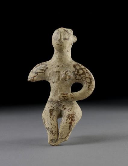 Terracotta figurine of a seated male