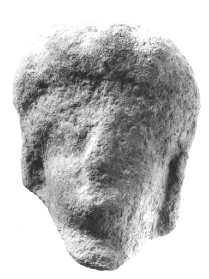 Head of terracotta figurine, woman with carved coiffure in front and bun at back