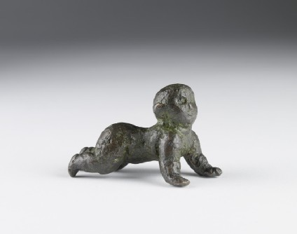 Bronze figurine of a crawling baby