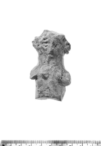 Upper section of female figurine