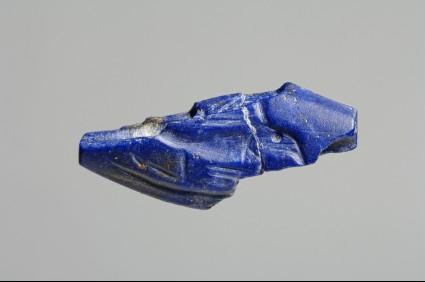 Broken amygdaloid seal depicting a bird in flight