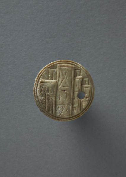 Bone gaming piece or token with inscription
