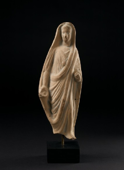 Terracotta statuette of a pious Roman veiling his head with his toga