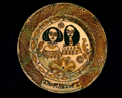 Staffordshire slip-decorated earthenware toft dish with images of the Duke of York and his wife Anne Hyde
