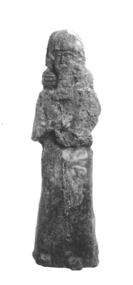 Figure of bearded warrior carrying a spear probably of a lahmu