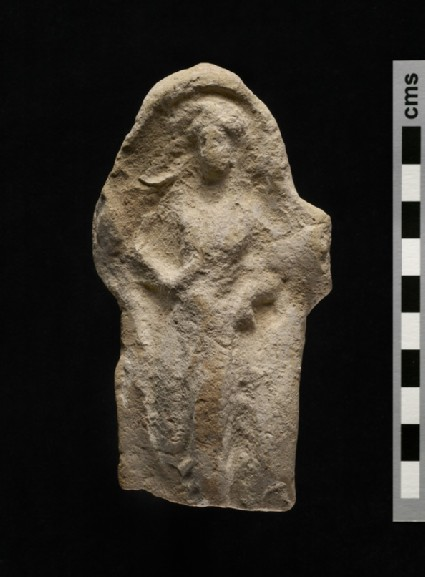 Terracotta relief plaque of draped female figure, bordered by bead moulding frame