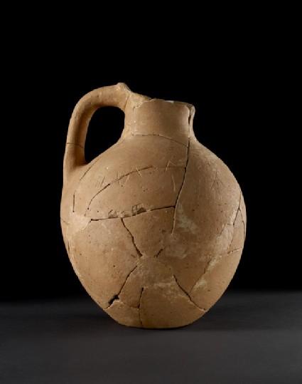 Plain jug with incised Cypro-Minoan signs (graffiti)