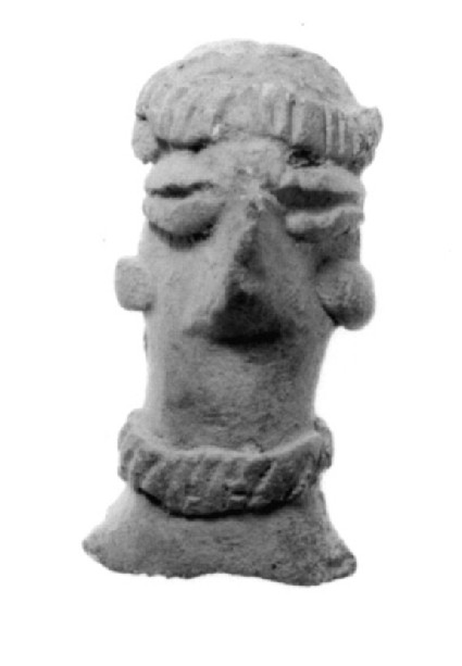 Female figurine fragment, four plaited locks falling behind head