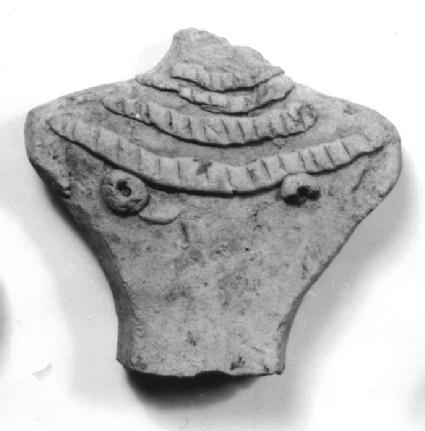 Upper part of a female figurine