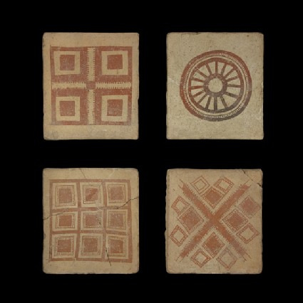 Tile with painted geometric design of four squares within a large square