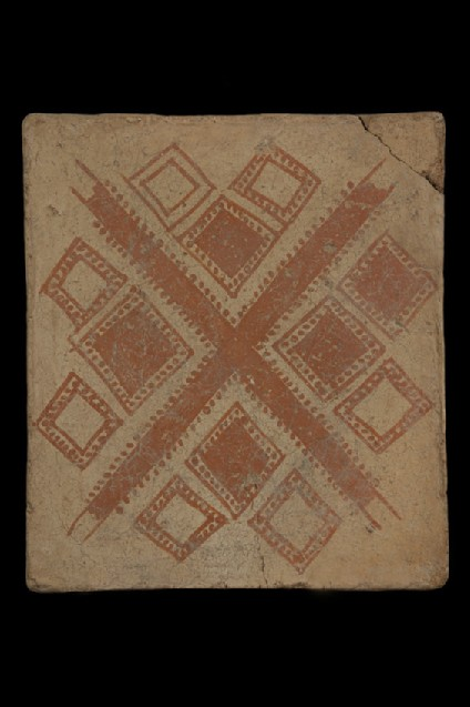 Terracotta tile with painted geometric design of central diagonal cross with three squares set within each opening